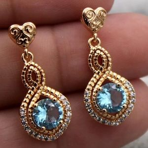 "New! 18k Gold Blue Topaz ""Figure 8"" earrings"